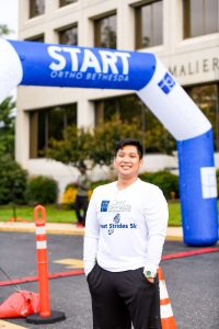 OrthoBethesda-5K-Event-Participant-At-Starting-Line