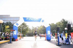 OrthoBethesda-5K-Runner-Crossing-Finish-Line