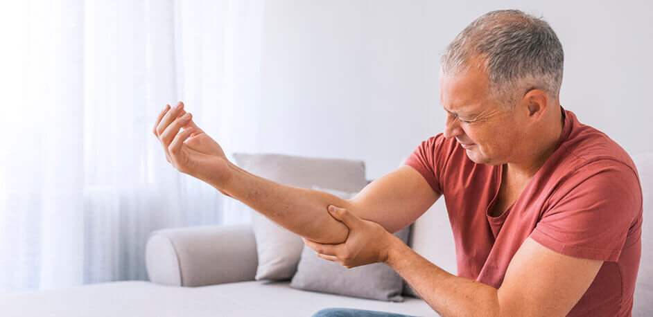 Man Experiencing Elbow Pain