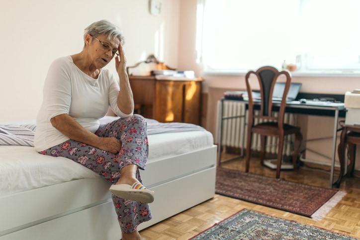 elderly woman suffering from vertigo