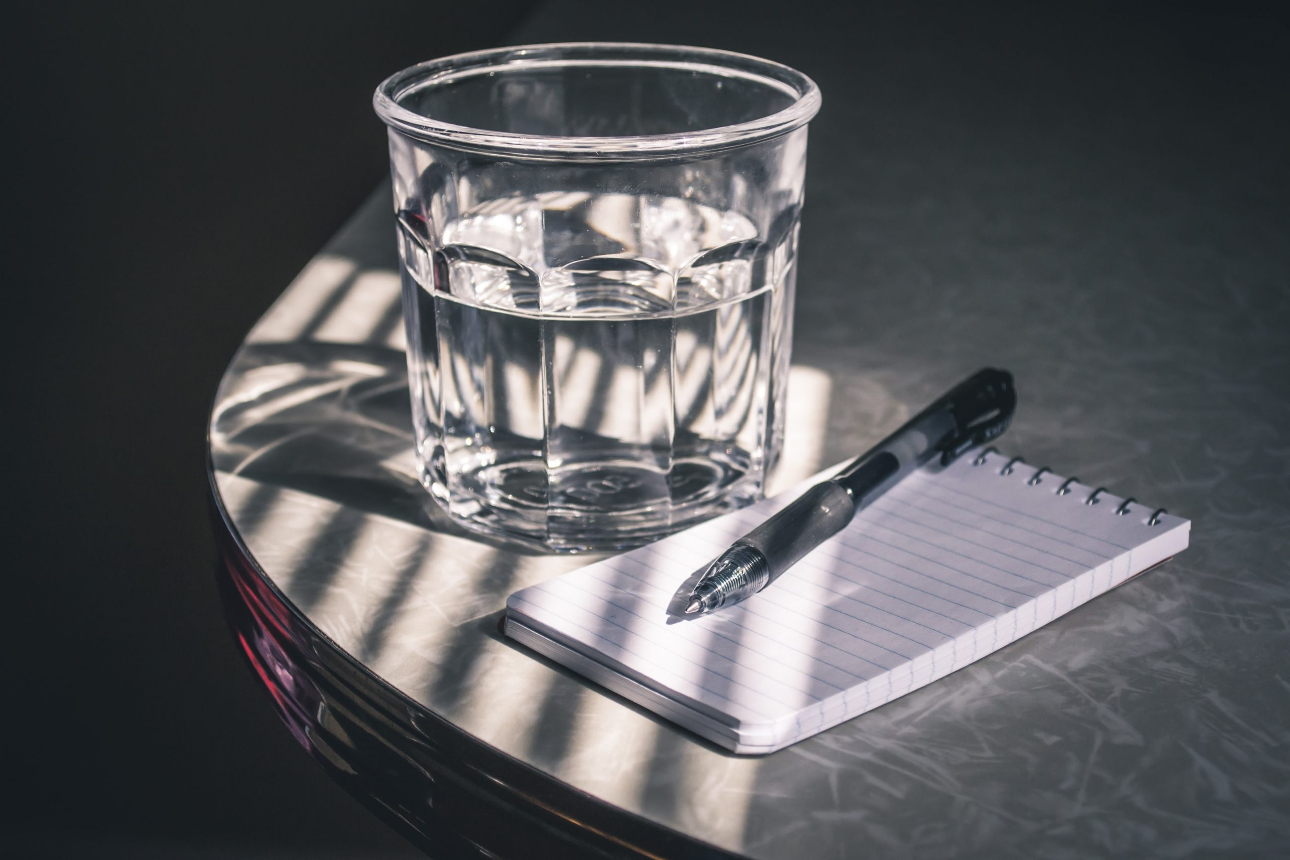 drinking glass and notepad