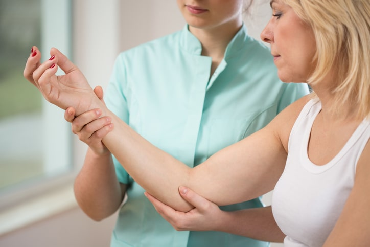 woman getting forearm examined